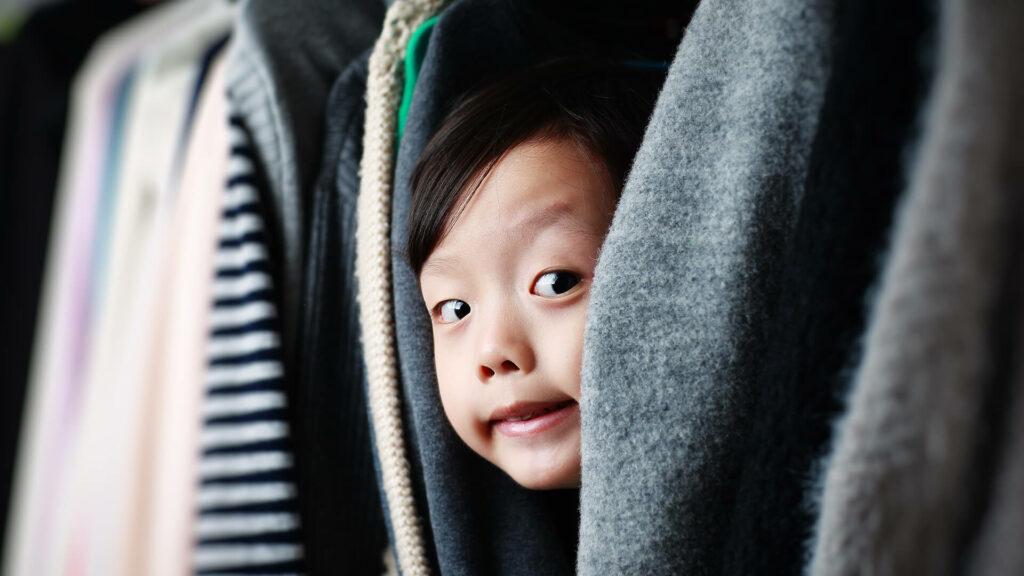 Kid playing hide and seek