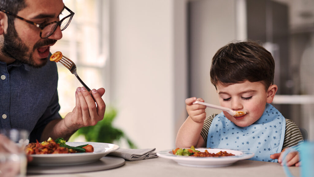 Toddler eating at table