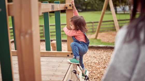 Toddler in playground climbing