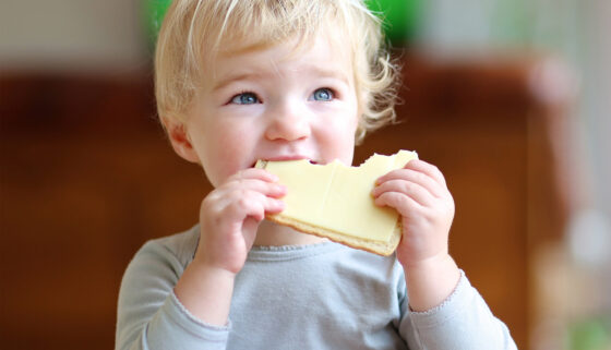 toddler eating cheese healthy eating support baby immune system | AptaNutrition
