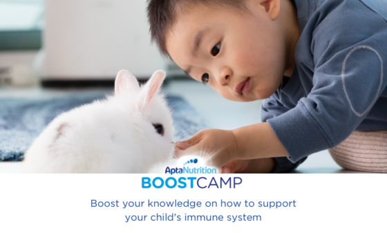 Resilience baby with pet rabbit Aptamil Boost camp
