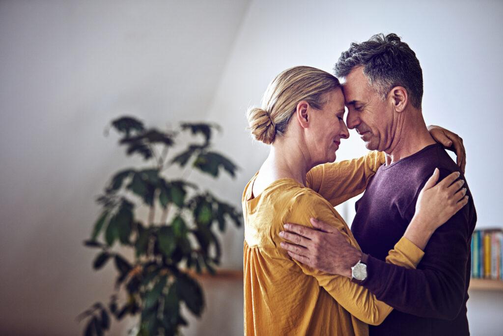 A mature couple hugging