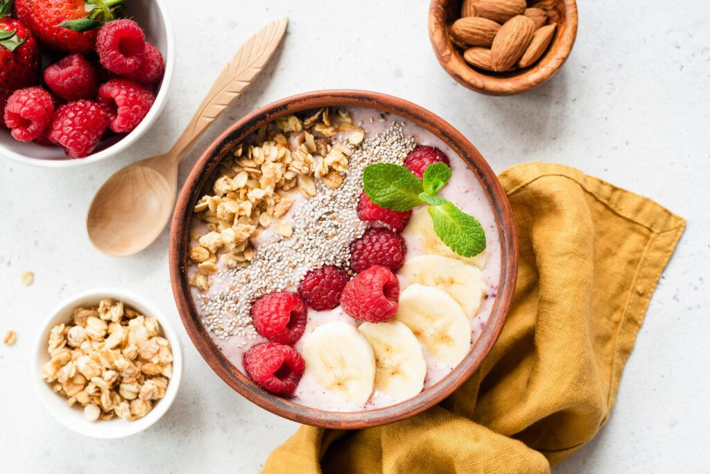 Fortisip Compact Protein Recipe: Strawberry and Acai smoothie smoothie bowl with superfood top view