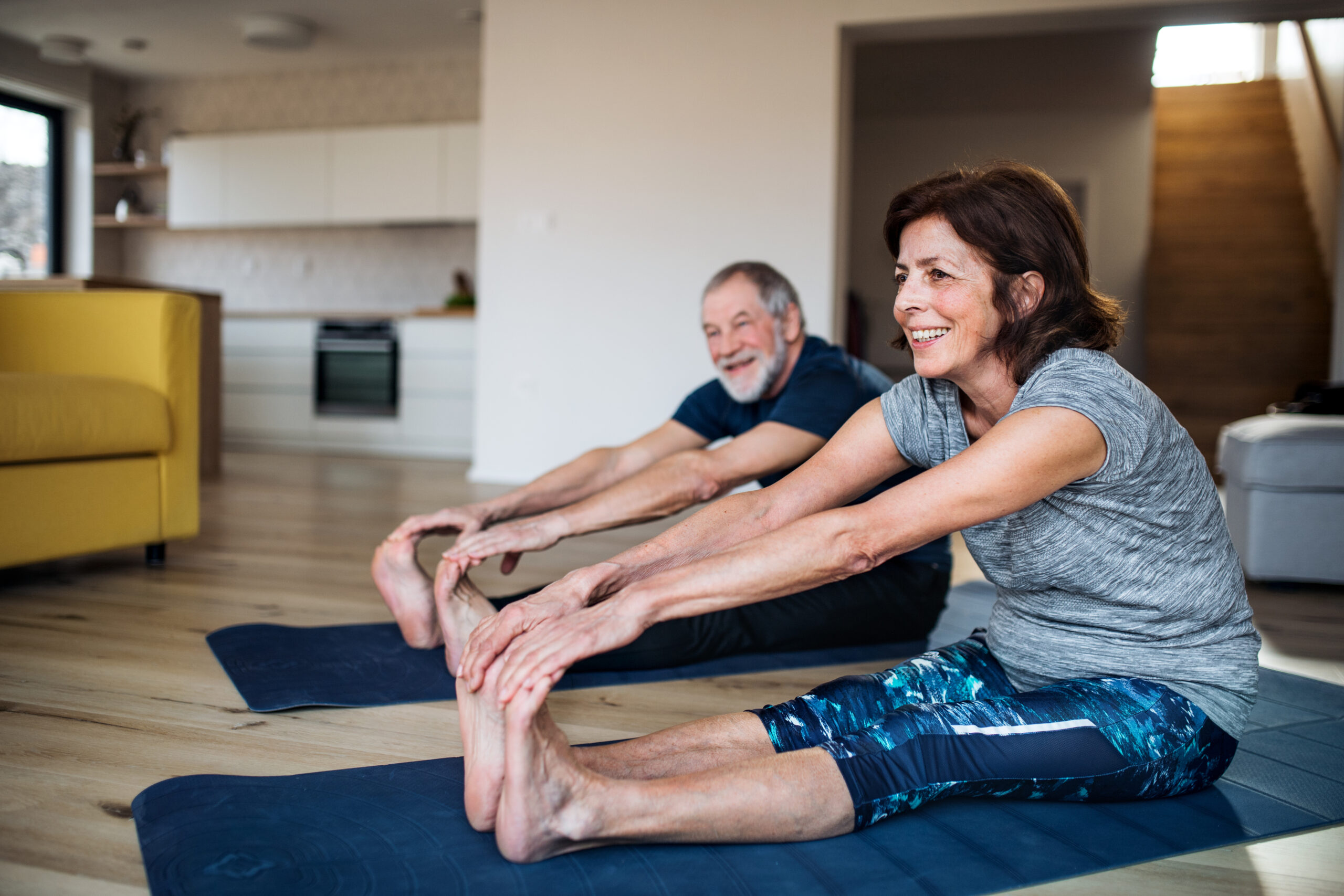 A mature couple exercising indoors