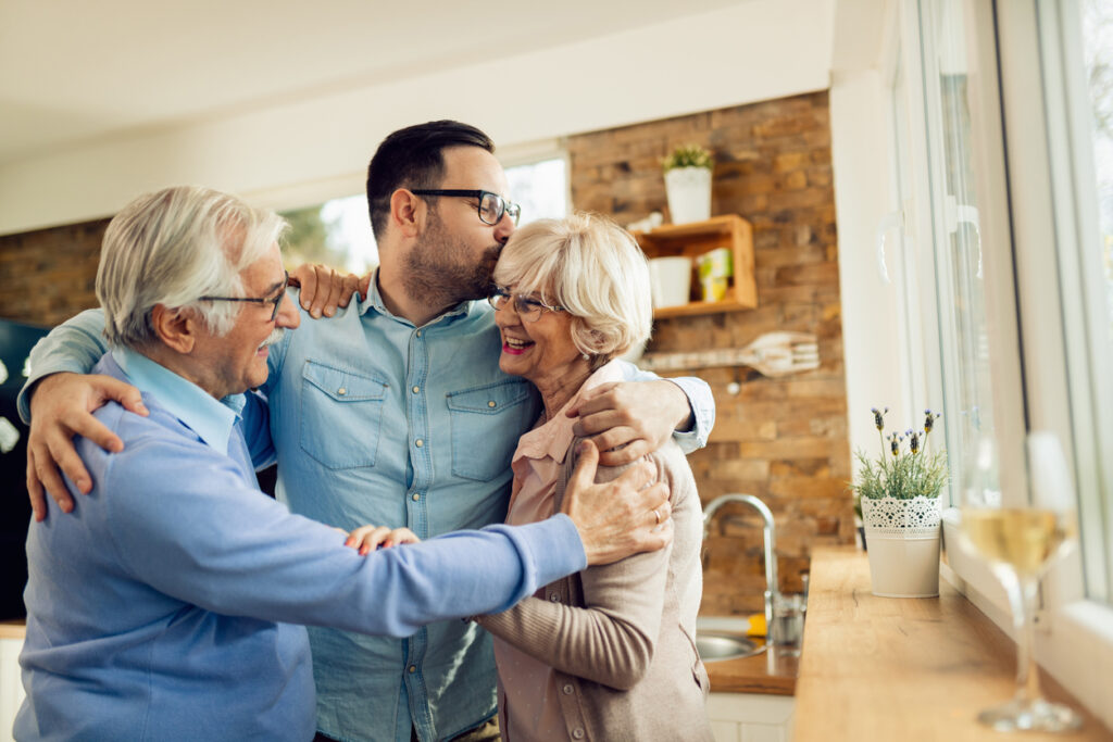 A family gathering and hugging each other | Nutricia